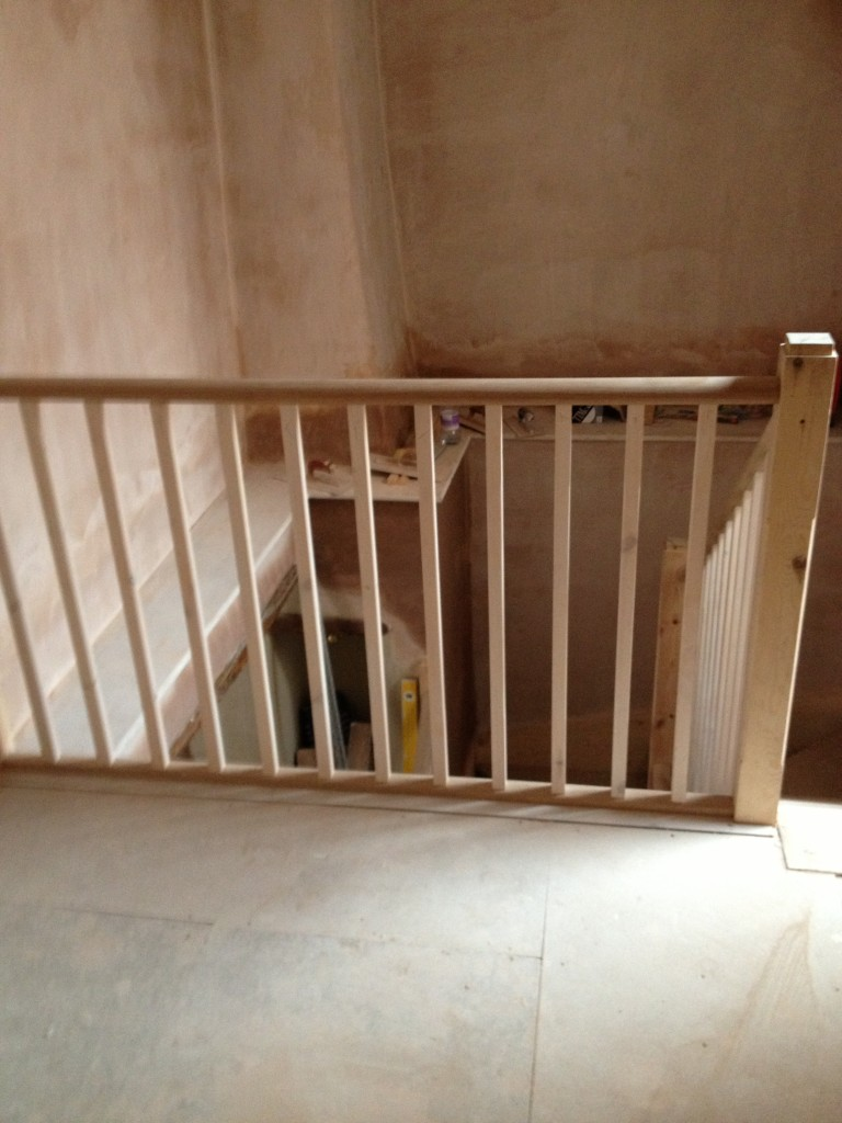 Newly installed wooden handrail on the landing